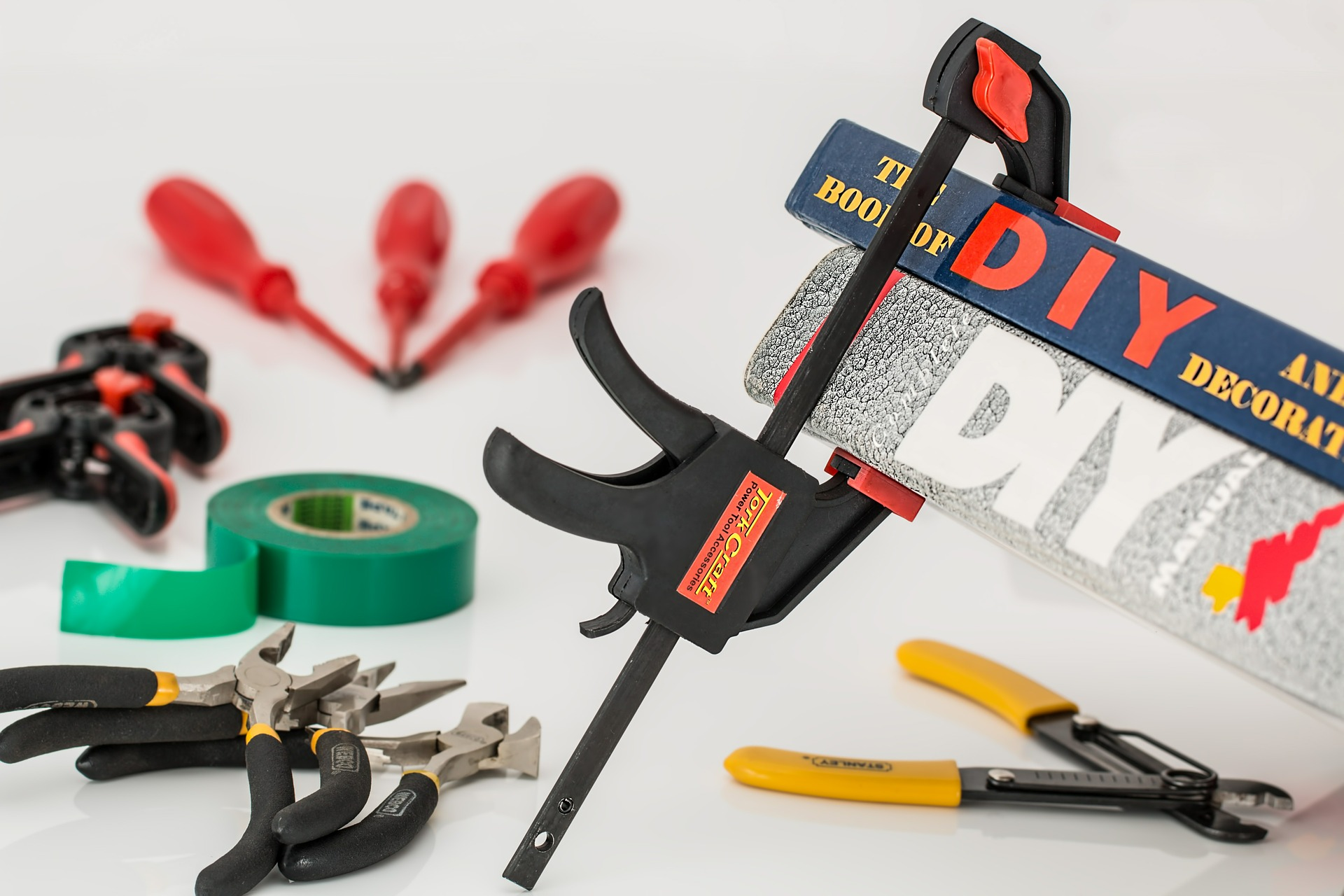 Crafting tools, tape, and a clamp