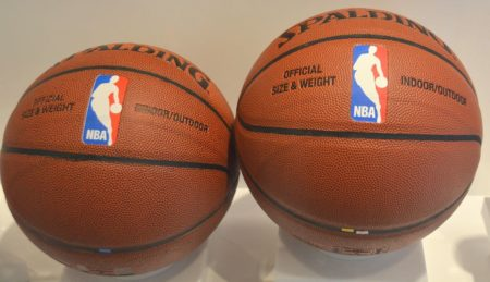 Authentic Spalding basketball next to a counterfeit