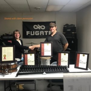 Lesley Wallerstein congratulates client Brett Fugate on his 4th and 5th patents